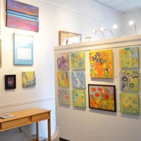 My art (the wall of abstracts on the right) continues to be on view at Austin Art Space